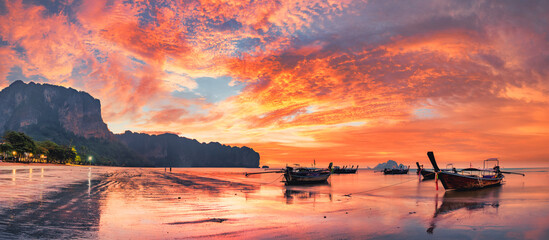 Traditional thai boats at sunset beach. Ao Nang Krabi province