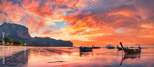 Fototapeta Traditional thai boats at sunset beach. Ao Nang Krabi province obraz