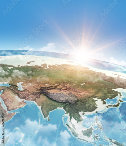 Obraz Sun shining in blue sky over the Earth - fototapety do salonu