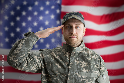 Military US Soldier Saluting Flag