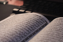 The Open Pages Of The Quran Are Read At Night