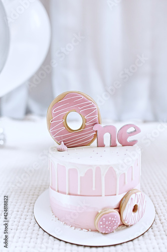 Fototapeta Birthday pink buttercream cake, decorated with meringue cookies for first birthday.  obraz
