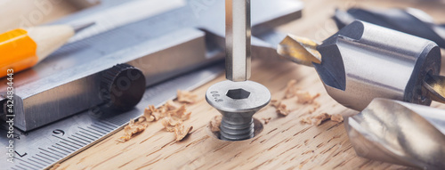 hex bolt screw by hex wrench in wooden oaks plate with with vernier caliper and Fototapet