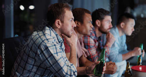 Nightlife. Friendship Concept. Multi-Ethnic Young People Best Friends Meeting and Watching TV Baseball Game Together Cheering and Toasting Beer.