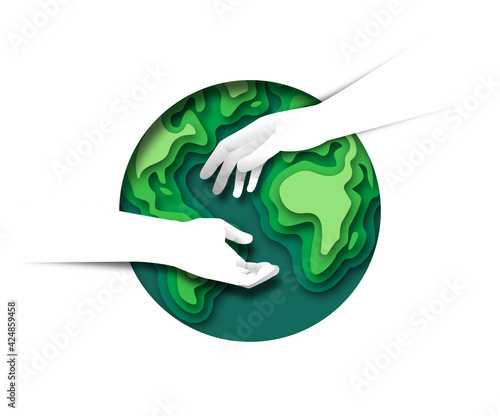 Obraz Two hands helping together paper cut earth - fototapety do salonu