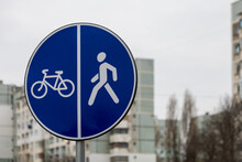 A Road Sign On The Sidewalk Indicating Bicycle And Footpaths. Background