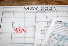 Internal Revenue Service (IRS) Has Extended The Deadline For Filing US Federal Income Tax Until May 17 2021. Concept Image Showing A Calendar Page Marking The New Tax Day For 2021.