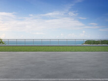 Gray Concrete Footpath On Green Grass Garden In Modern City Park. Road 3d Rendering With Beach And Sea View.
