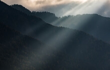 Light Beam And Fog Over The Mountains