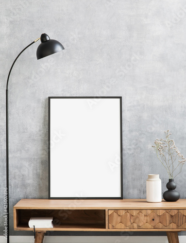 Blank picture frame mockup on gray wall. Living room design. View of modern style interior. Home staging and minimalism concept. Artwork poster showcase.