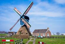 Windmill Under The Clear Sunny Sky