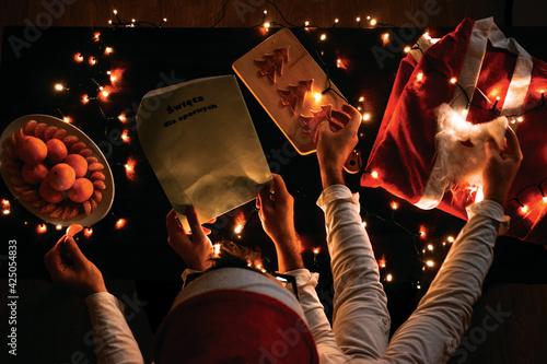 Obraz na plátně Christmas preperation with multiple hands