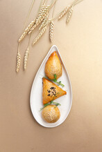 Traditional Uzbek Pastries. On A Brown Background.
