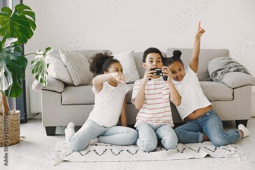 Children play in video games at home on floor Fototapeta