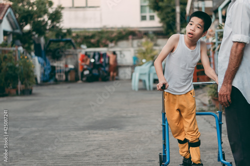 Tela Disabled child is doing physical with father in the evening, He is ready to practice, Special children's lifestyle, Life in the education age of special need children, Happy disability kid concept