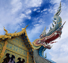 Dragon Guard - Exterior Detail Of Famous Wat Rong Suea Ten, Or Blue Temple In Chiangrai, Chiang Rai Province, Northern Thailand