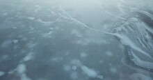 Flying Low Over An Amazing Frozen Lake With Deep And Varied Ice Formations