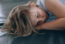 Sad Girl Lies On The Floor