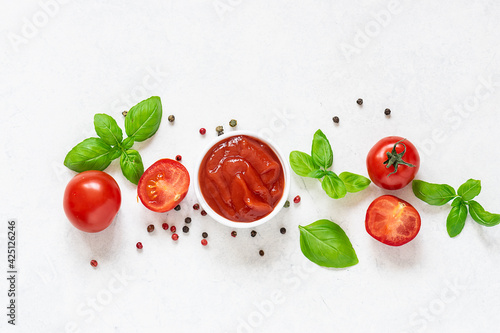 Homemade tomato sauce with fresh aromatic basil, cherry tomatoes, peppercorn and garlic on white marble background Wallpaper Mural