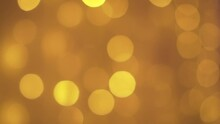 Bokeh Lights In Yellow Orange Colour. Shallow Depth Of Field Zoom In Shot