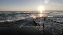 A Slow Motion Clip Of Waves Crashing Up Towards Camera Splashing Up