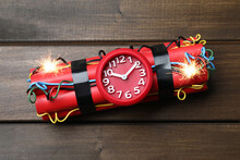 Dynamite Time Bomb On Wooden Table, Top View