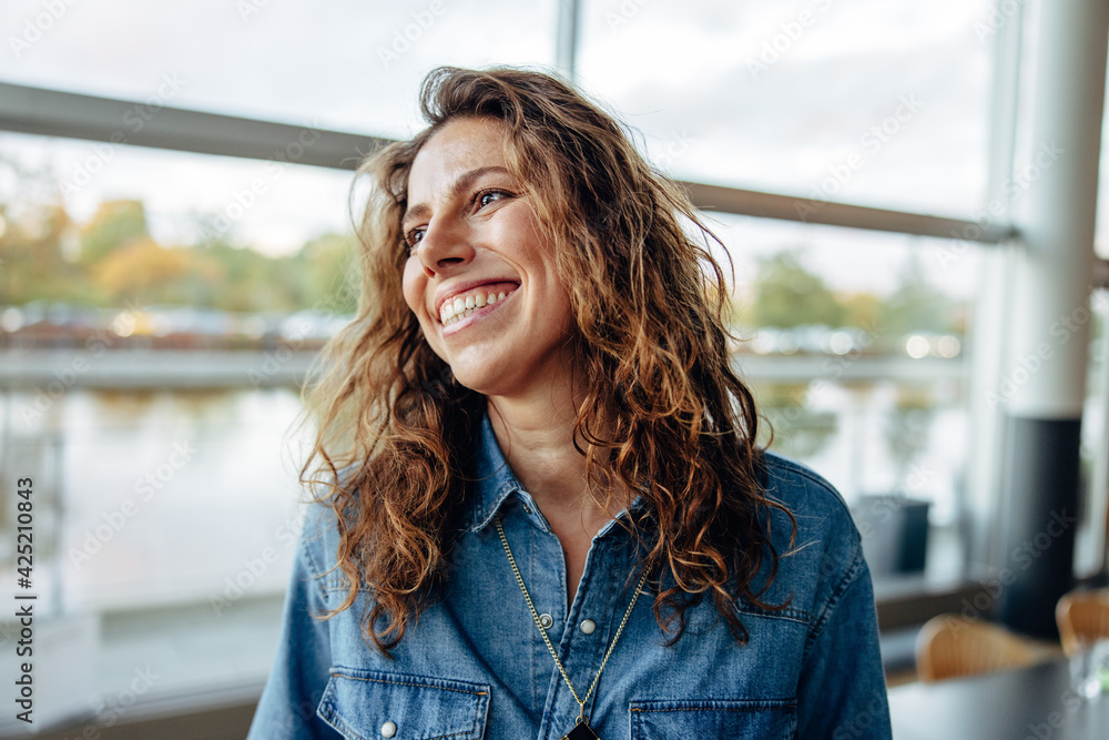 Fototapeta Businesswoman looking away and smiling