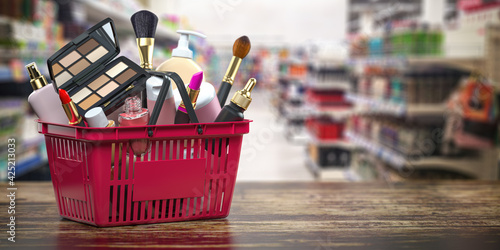 Obraz Cosmetics in shopping basket on shelf in shop. Beauty and make up products sale and purchasing online concept. - fototapety do salonu