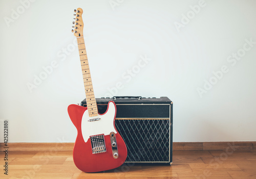 Obraz na plátně Red electric guitar and classic amplifier