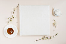 White Family Or Wedding Photo Album With Apple Flowers And Cup Of Tea And Marshmallow