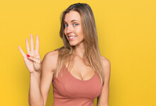 Beautiful Caucasian Woman Wearing Casual Clothes Showing And Pointing Up With Fingers Number Four While Smiling Confident And Happy.