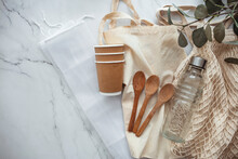 Eco Friendly Accessories - Bamboo Cutlery, Eco Bag, Reusable Water Bottle. Zero Waste, Plastic Free Concept, Sustainable Lifestyle. Top View, Flat Lay.