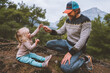 Leinwandbild Motiv Father and daughter child playing outdoor in forest travel family lifestyle summer vacations happy emotions