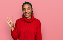 African American Woman Wearing Casual Winter Sweater Showing And Pointing Up With Fingers Number Four While Smiling Confident And Happy.