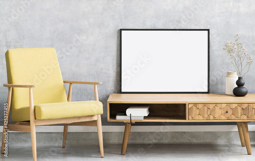 Obraz Blank picture frame mockup on gray wall. Living room design. View of modern style interior with chair. Home staging and minimalism concept - fototapety do salonu