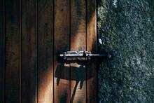 Part Of Closed Wooden Door With Metal Bolt