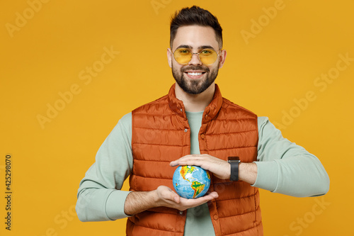 Obraz na plátně Young smiling happy geography student teacher fun caucasian man 20s wearing oran