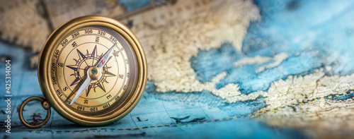 Fotografie, Obraz Magnetic old compass on world map