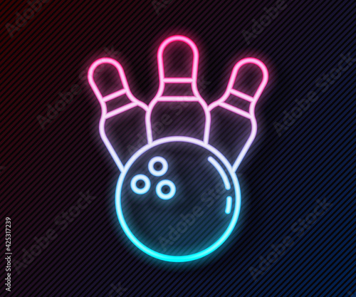 Slika na platnu Glowing neon line Bowling pin and ball icon isolated on black background