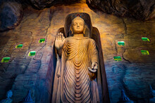 Large Stone Statue Of Buddha In A Cave In Wat Saket Golden Mountain Temple Famous Landmark In Bangkok, Thailand.