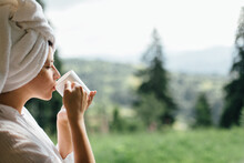 Beautiful Woman Enjoying Sunny Morning With Cup Of Coffee At Mountain Hills, Tranquil.Space For Text
