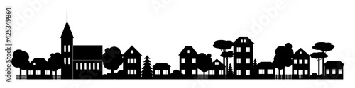 Fotografie, Obraz Small Town silhouette cutout skyline with chapel houses trees black and white
