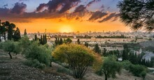 Beautiful Dramatic Autumn Sunset Over The Old City Jerusalem, With The Dome Of The Rock, The Golden Gate And The Russian Orthodox Church Of Mary Magdalene Seen Through Fall Trees On Mount Of Olives