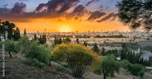 Fototapeta Beautiful dramatic autumn sunset over the Old City Jerusalem, with the Dome of t