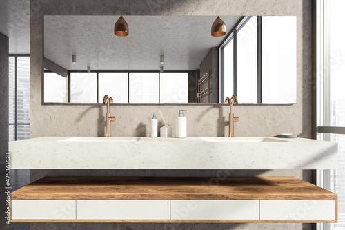 Obraz Bathroom interior with sinks with mirror, window with city view - fototapety do salonu