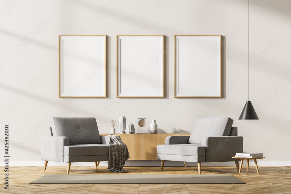 Fototapeta Beige living room interior with armchairs and drawer, mockup posters
