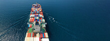 Aerial Drone Ultra Wide Photo Of Huge Container Ship Cruising Deep Blue Open Ocean Sea Near Logistics Container Terminal Port