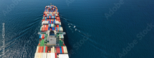 Fotografie, Obraz Aerial drone ultra wide photo of huge container ship cruising deep blue open oce