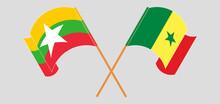 Crossed And Waving Flags Of Myanmar And Senegal
