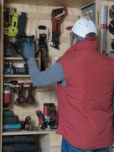 Boy With Cap And Red Waistcoat Preparing DIY Tools On A Homemade Wooden Shelf